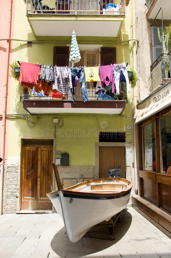 House located in riomaggiore parked with a boat. Italy stock photo