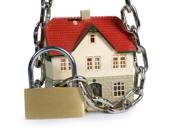 House locked with padlock royalty free stock photo