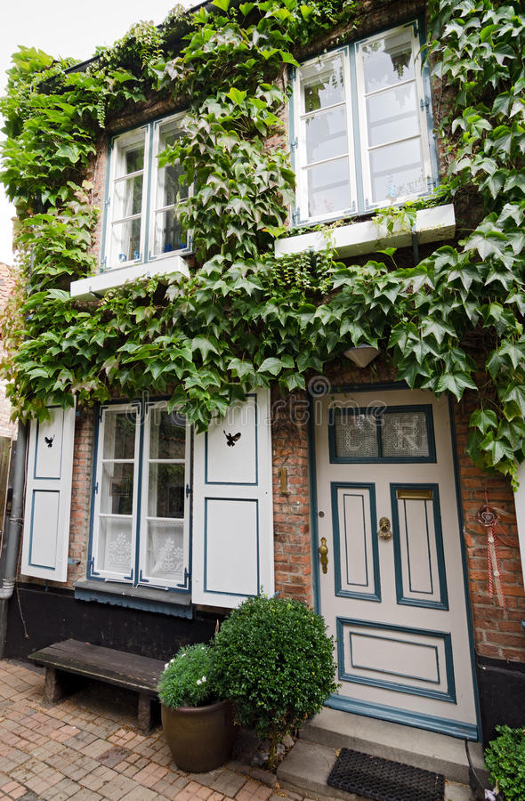 House in Lubeck. House with ivy covered facade in Lubeck, Germany royalty free stock image