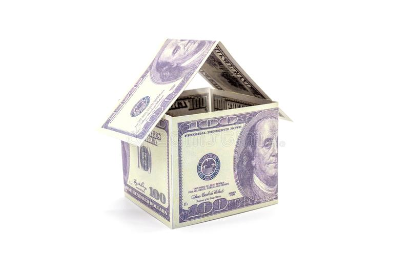 House made of cash Dollar money isolated on white background.  stock photography