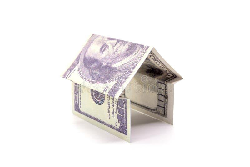 House made of cash Dollar money isolated on white background.  royalty free stock images