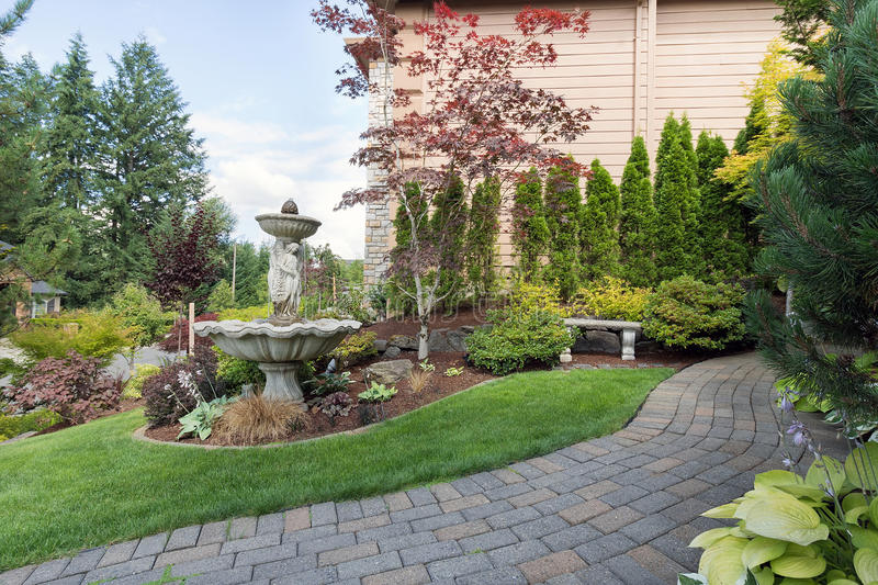 Download House Manicured Frontyard With Water Fountain Stock Photo   Image:  74817952