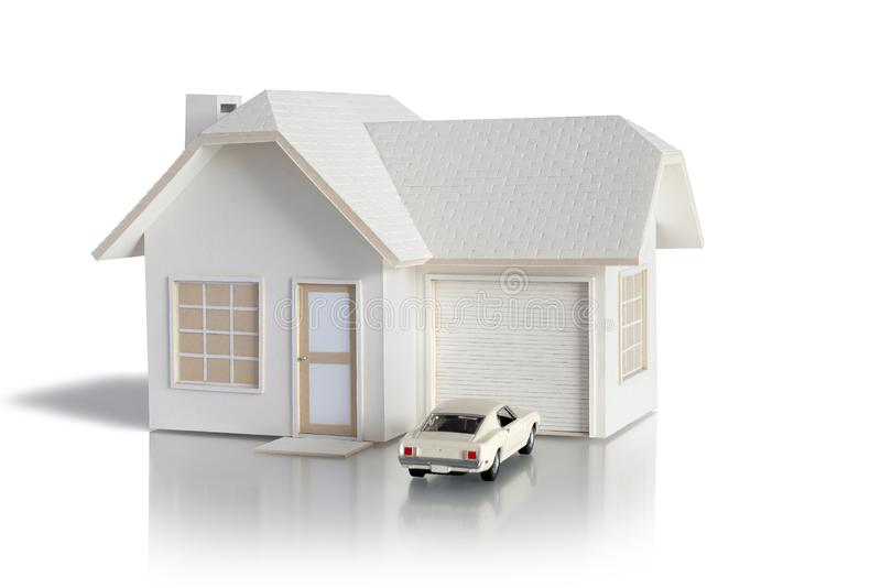 House miniature with car isolated in white background for real estate and construction concepts. House miniature designed and crea stock photo