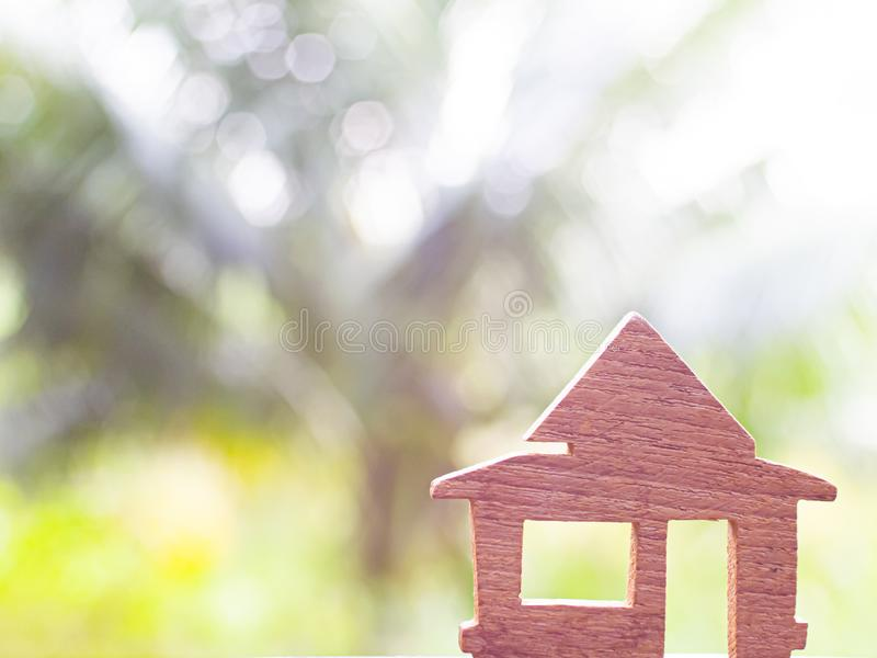 Wooden House Model Home Housing and Real Estate concept. House model. Affordable housing concepts. Wooden House Model on wooden floor with blackboard texture stock photo