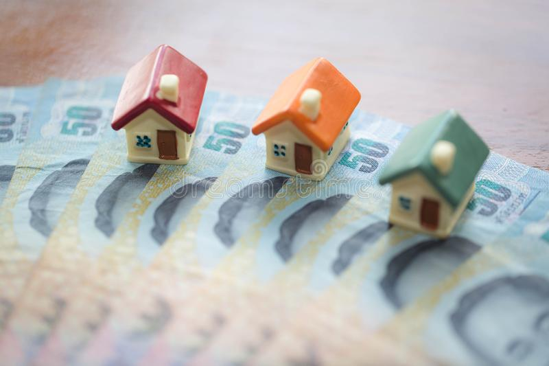 House model on banknotes, Saving money for real estate concept, House model, for pay loan, concept of buying a sale, lease,. Loan, ecological housing. business stock photography