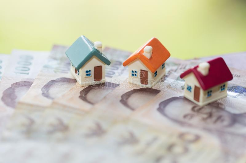 House model on banknotes, Saving money for real estate concept, House model, for pay loan, concept of buying a sale, lease,. Loan, ecological housing. business royalty free stock photography