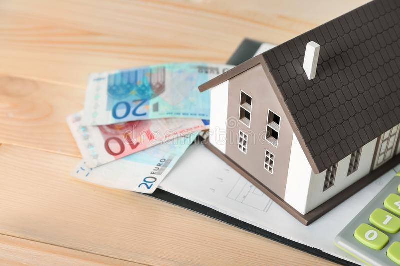 House model and banknotes on wooden table, closeup. Mortgage concept royalty free stock photos