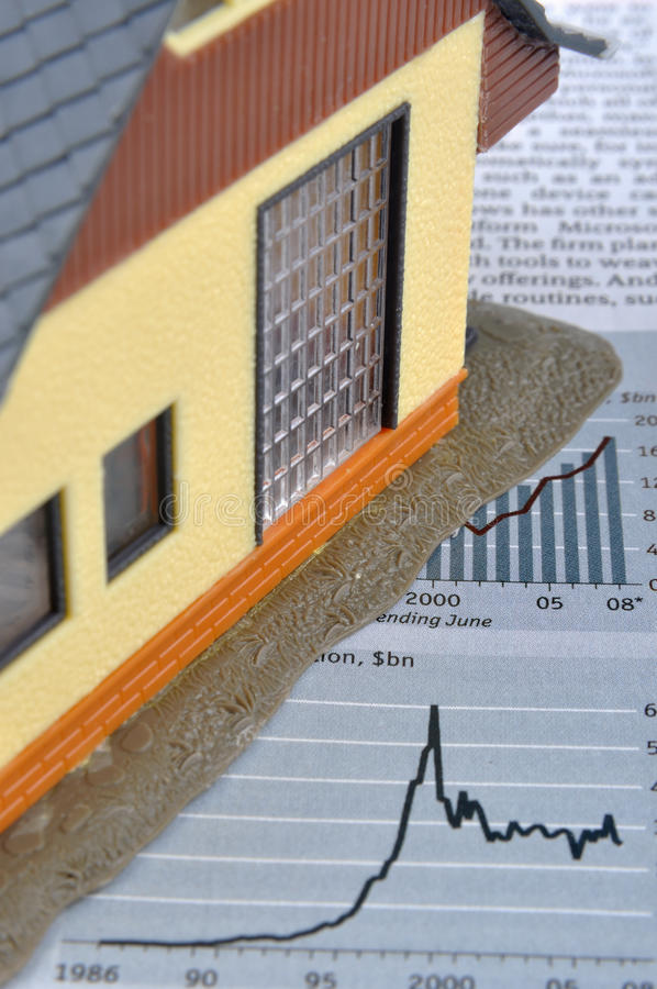 House model and chart. House model and economy article and chart, means situation or information about real estate and economy, investment or house building stock image