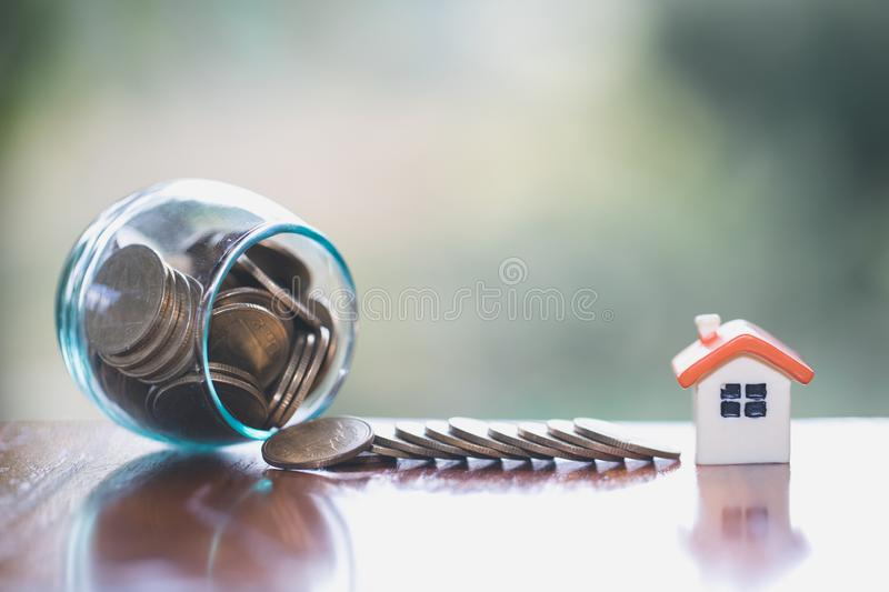 House model and coin, Concept of property management, home, Invesment and Risk Management.  stock photos
