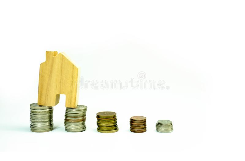 House model on coin pile saving for concept with isolated on white background.Concept for property ladder, mortgage and real. Estate investment. investment royalty free stock photos