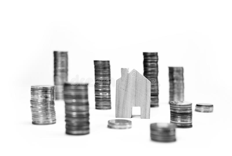 House model on coin pile saving for concept with isolated on white background.Concept for property ladder, mortgage and real. Estate investment. home loan and stock photography