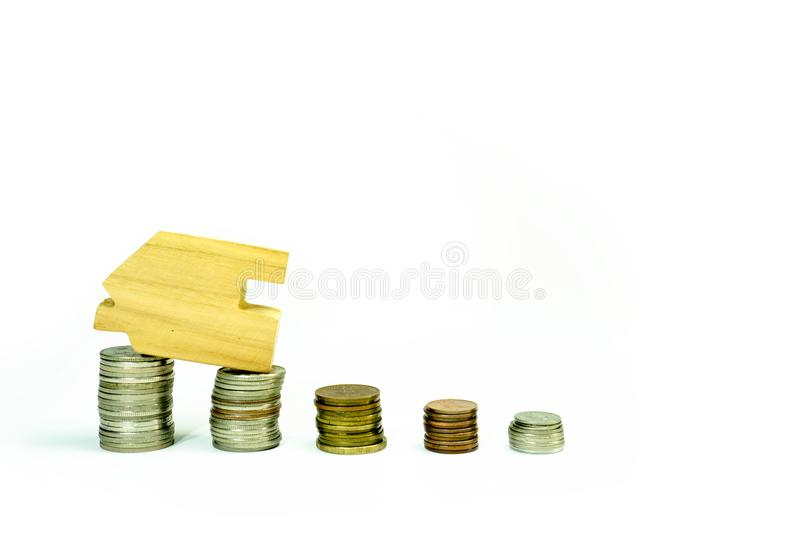House model on coin pile saving for concept with isolated on white background.Concept for property ladder, mortgage and real. Estate investment. home loan and royalty free stock photo