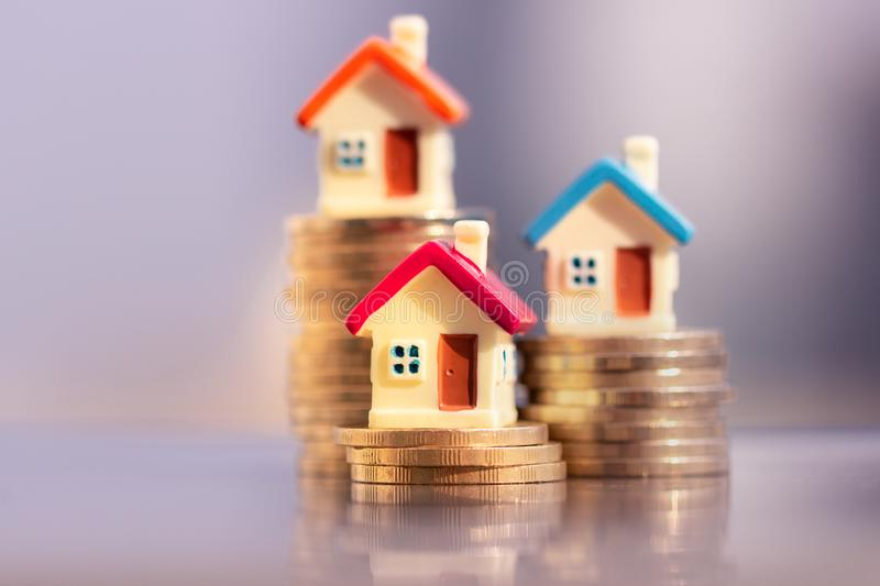 House model on coins stack. planning savings money of coins to buy a home concept. royalty free stock image
