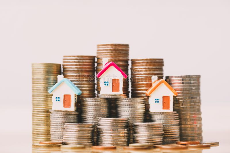 House model on coins stack. planning savings money of coins to buy a home concept, mortgage and real estate investment. royalty free stock photography
