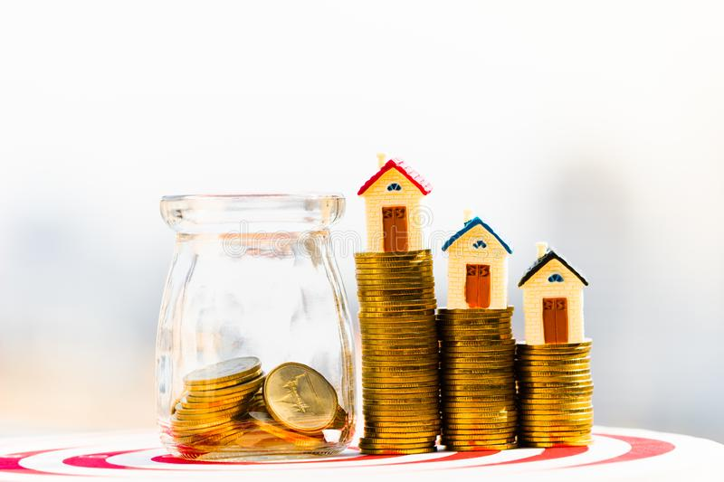 House model on coins stack. planning savings money of coins to buy a home concept. royalty free stock images
