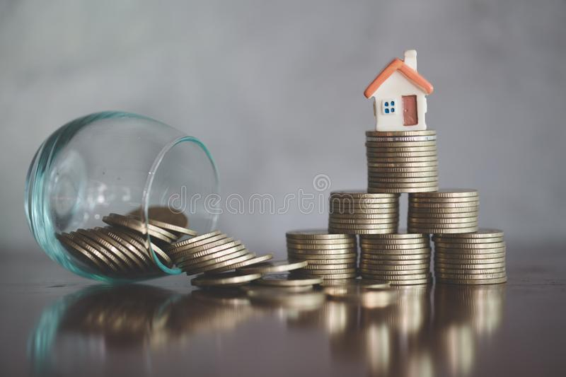 House model on coins stacks, Concept for property ladder, mortgage and real estate investment.  stock photography