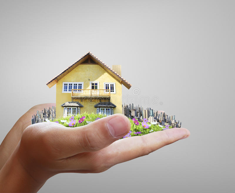 House model concept in hand stock image