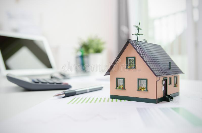 House model on desk, mortgage or house building concept. House model on desk, mortgage, investment or house building concept royalty free stock images