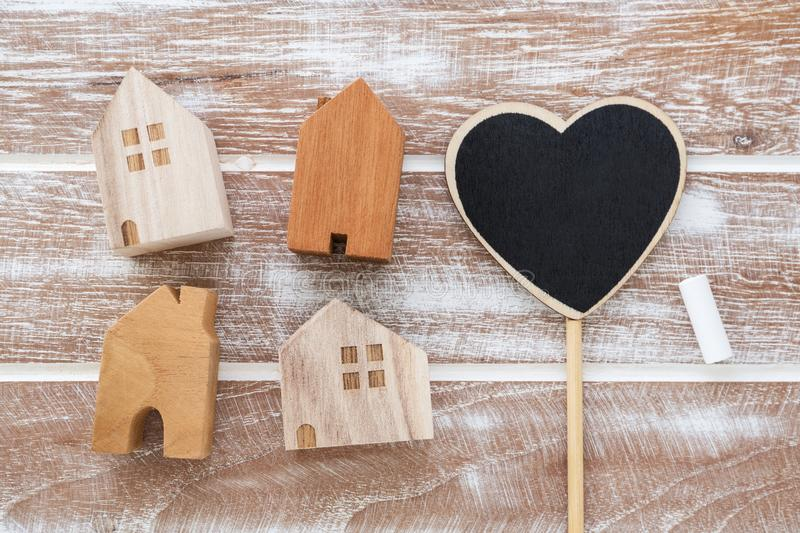 House model with heart sign. On wooden table background from top view stock image
