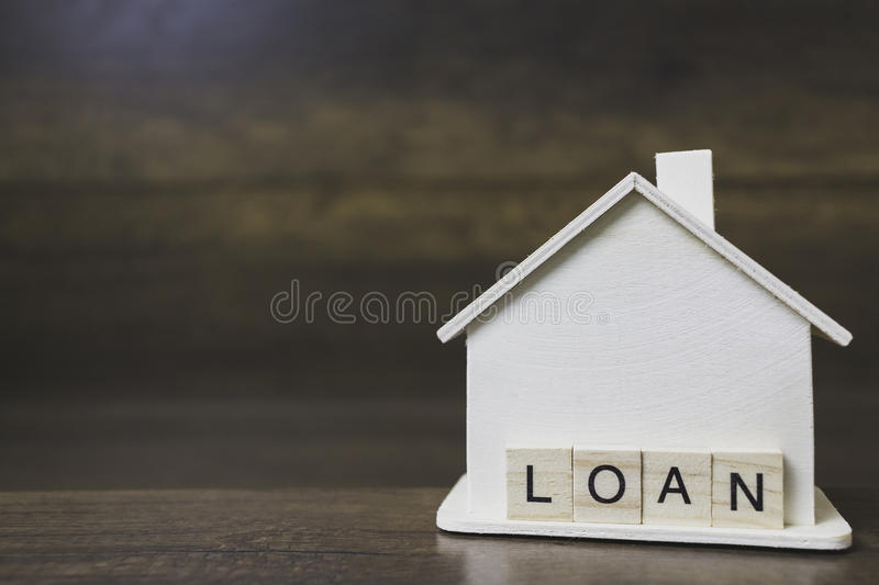 House model with loan word on wooden blocks royalty free stock photos