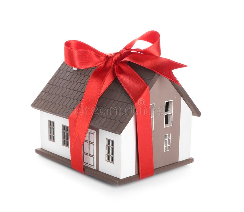 House model with red ribbon on white background. Mortgage concept stock image