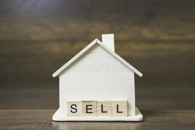 House model with Sell word on wooden blocks. royalty free stock photos