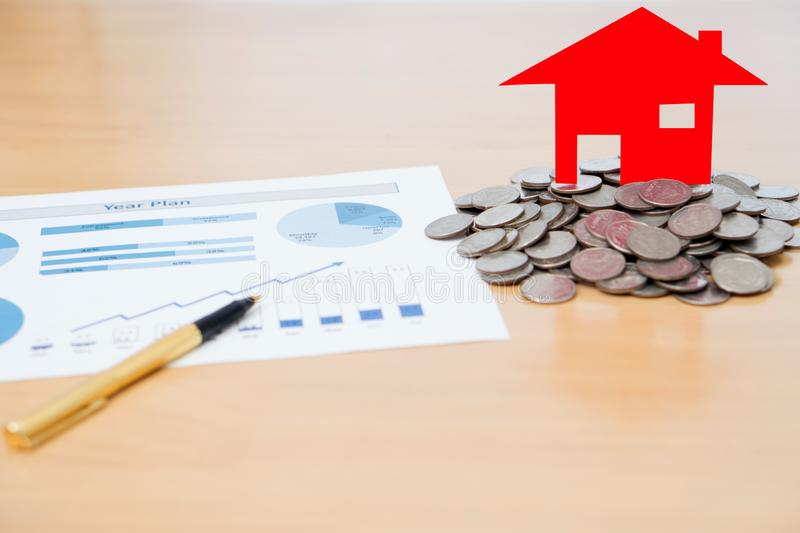 House Model And Stack Of Coins. On Desk stock image