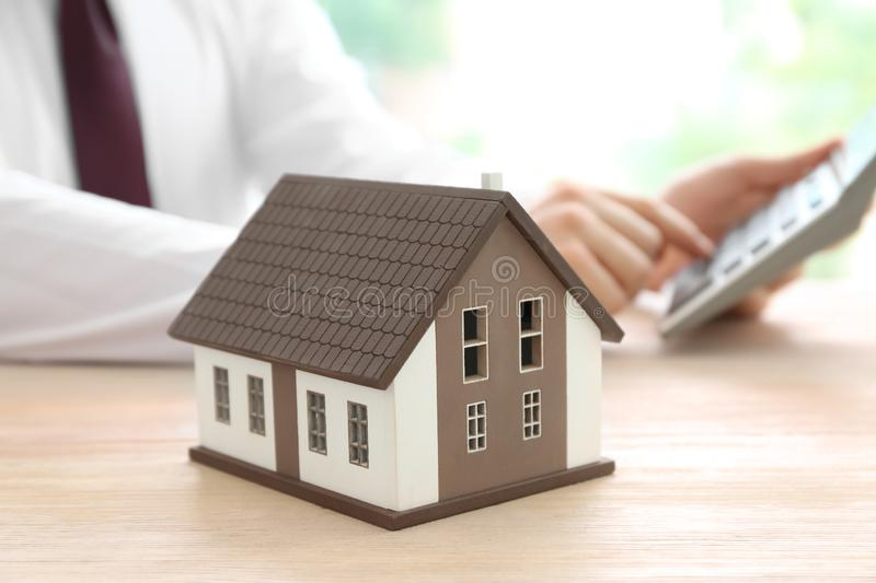 House model on table of real estate agent stock photo