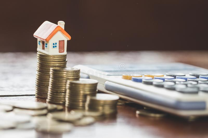 House model on top of stack of money as growth of mortgage credit, Concept of property management. Invesment and Risk Management.  royalty free stock photography