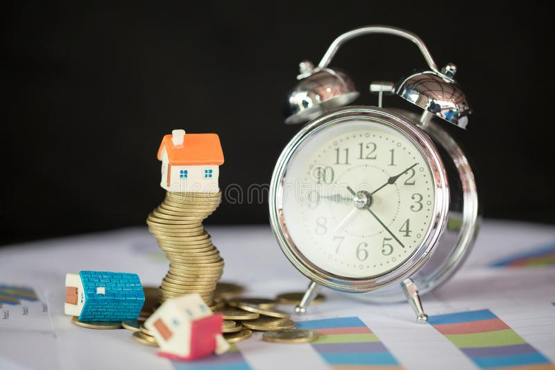 House model on top of stack of money as growth of mortgage credit, Concept of property management. Invesment and Risk Management stock photography