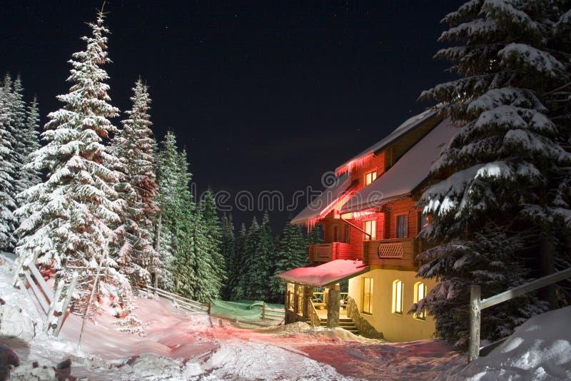 House in mountains stock photos
