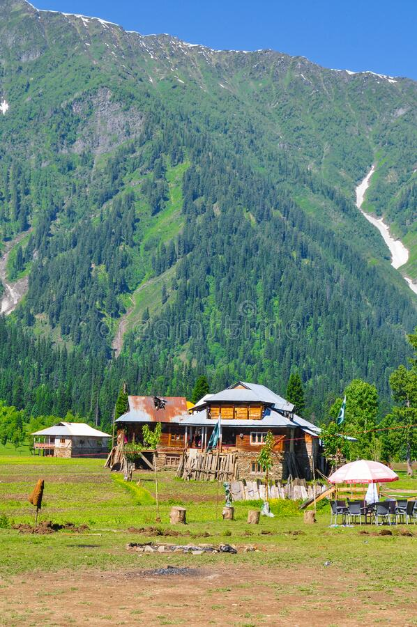House, Mountains and trees in Azad jammu and kashmir. Beautiful picture of house, mountains and forests during daytime in Azad jammu and kashmir, Pakistan royalty free stock image