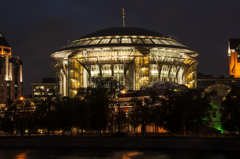 House of Music in Moscow. Night view of the waterfront. royalty free stock image