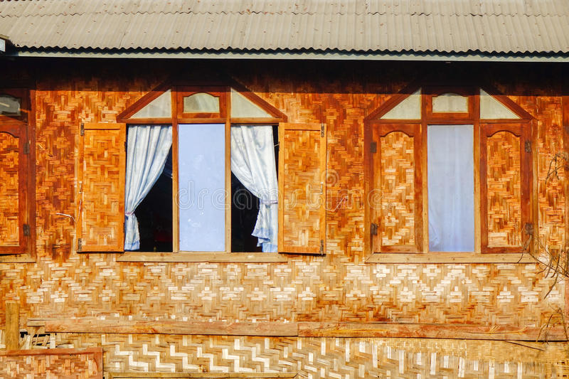 House in Myanmar. Windows of the Burmese house on stilts, Myanmar. Myanmar is one of the mysterious country in South East Asia and because of its cultural and stock photo