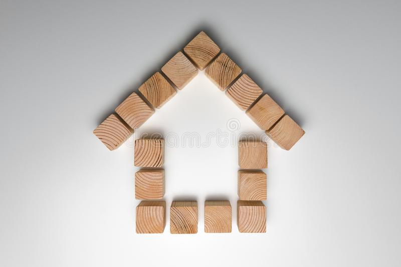 House of natural colored toy blocks on white background. House building concept. In a natural light royalty free stock photos