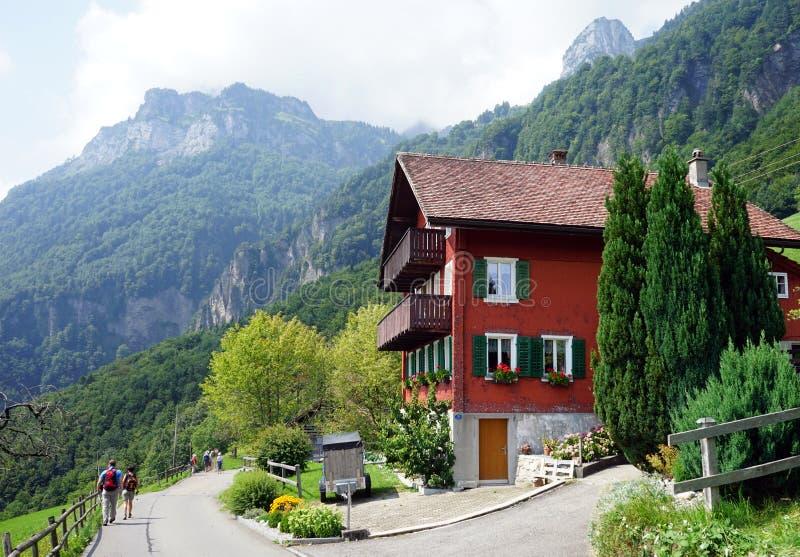 House near road. BAUEN, SWITZERLAND - CIRCA AUGUST 2015 House near road stock photo