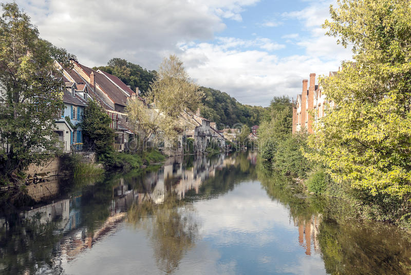 House nears the river. House along the river in France on a sunny day stock photo