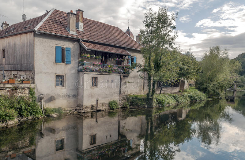House nears the river. House along the river in France on a sunny day royalty free stock photography