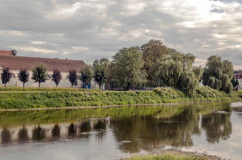 House nears the river. House along the river in France on a sunny day royalty free stock photo