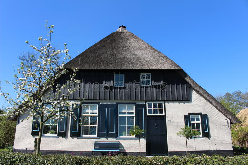 House in Netherlands. House with black roof in Netherlands royalty free stock photo