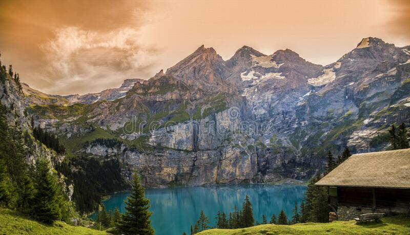 House next to alpine lake royalty free stock image