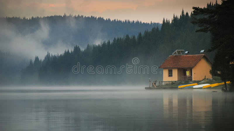 House next to the lake. stock photography