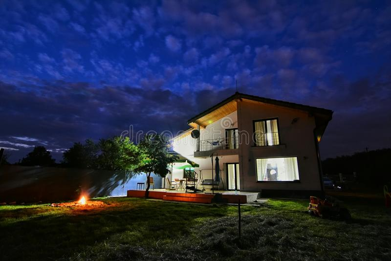 House by night. Backyard and house in night scene stock photography