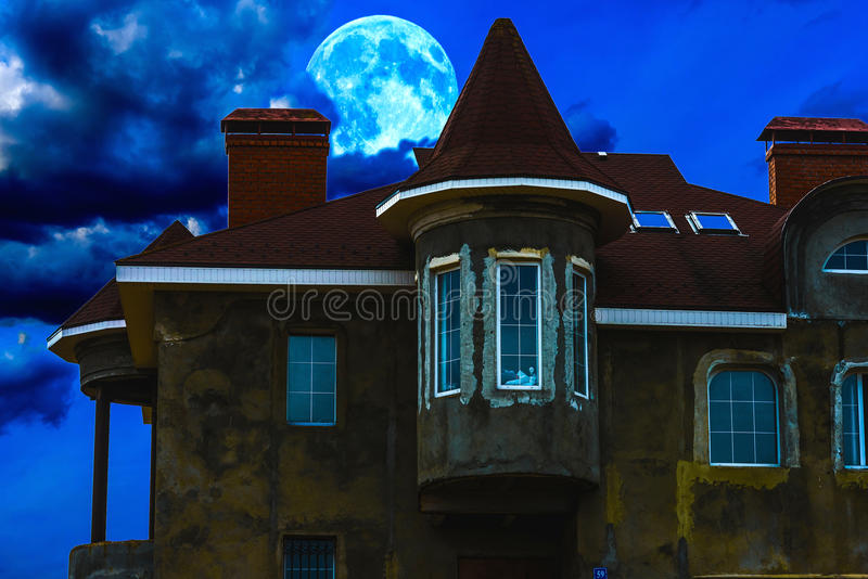 House night and the moon stock photos