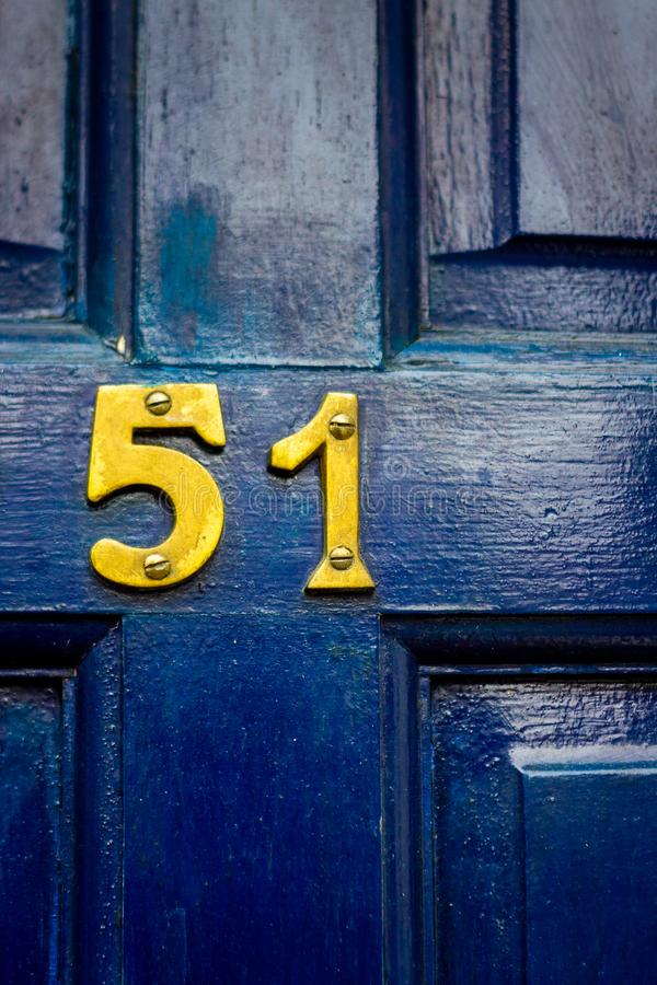 Free House Number 51 On A Dark Blue Wooden Front Door Stock Photos - 167354973