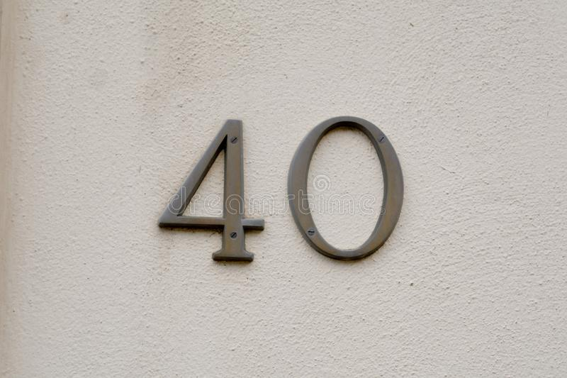 House number 40 sign on wall. Of home royalty free stock photography
