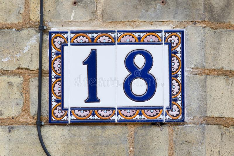 House Number 18 sign on wall royalty free stock photo