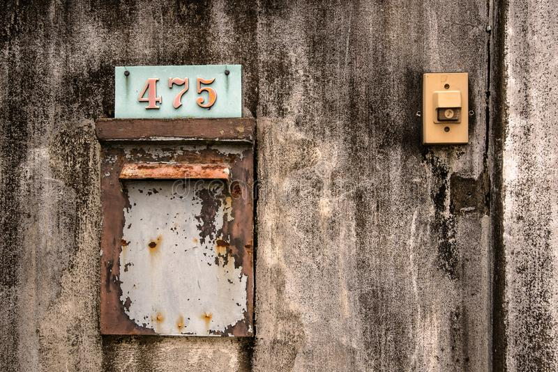 House number signs and old wall bell stock photo