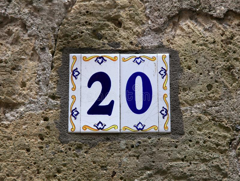 Download house number twenty 20 ceramic tiles with blue figures on old stone wall