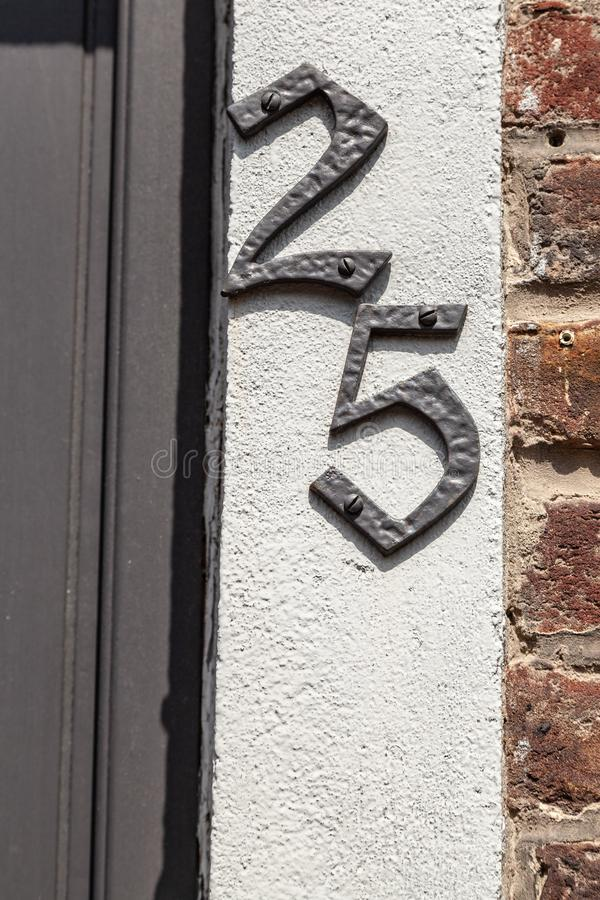 House number twenty-five 25 cast metal textured stock photography